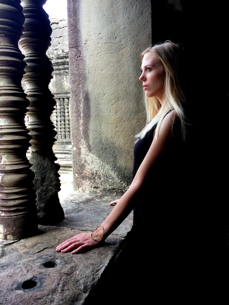 model posing at Angkor wat
