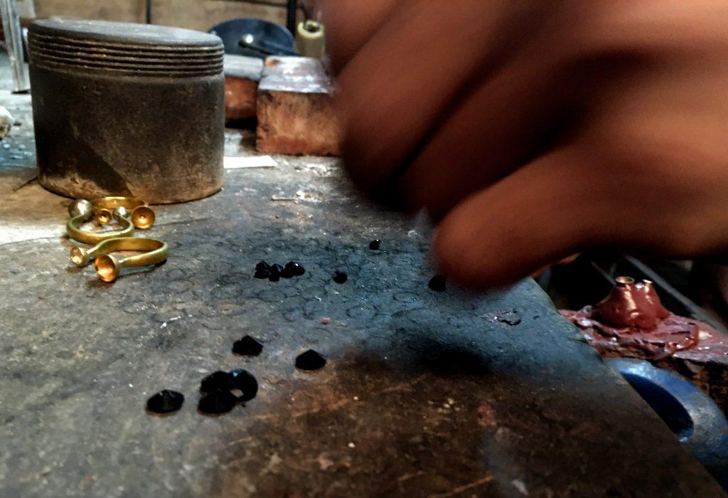 artisan making rings
