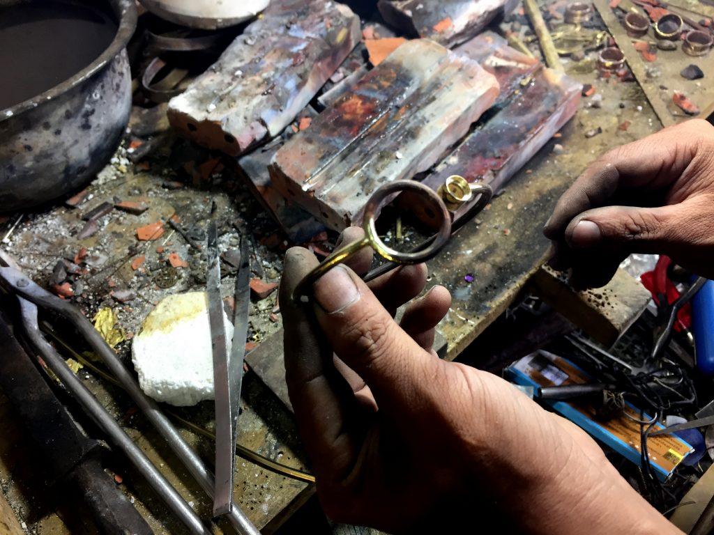 artisan making a bracelet