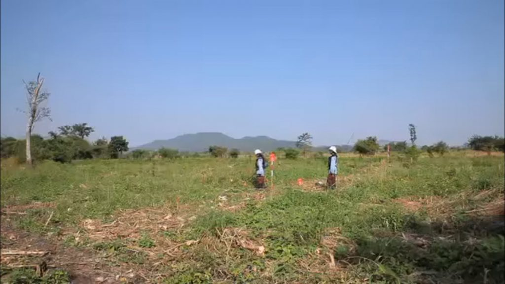 The Landmine Girls in a field